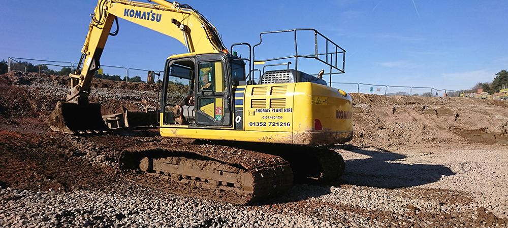 Materials Management header image showing an excavator moving material